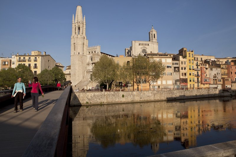 Church towers rise above the River Onyar in the ancient Spanish city of Girona, which recently rediscovered its old Jewish quarter and rebuilt part of its medieval ramparts. SPAIN GIRONA EUROPE FOOD CUISINE