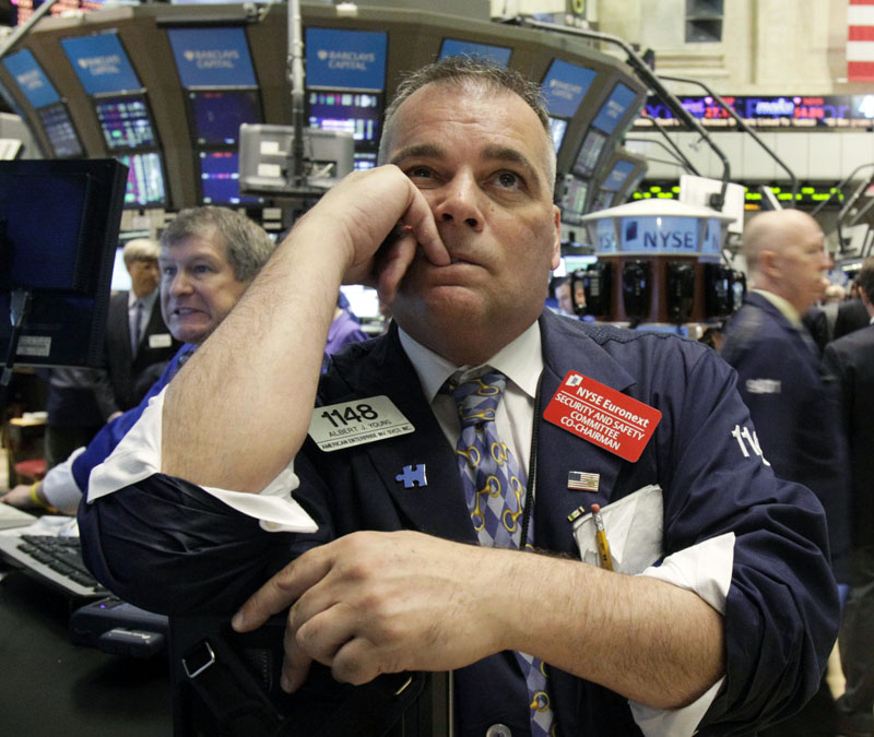 Trader Albert Young watches the numbers on the floor of the New York Stock Exchange today.