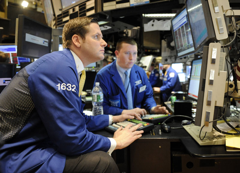 Traders work on the floor of the New York Stock Exchange today in New York.