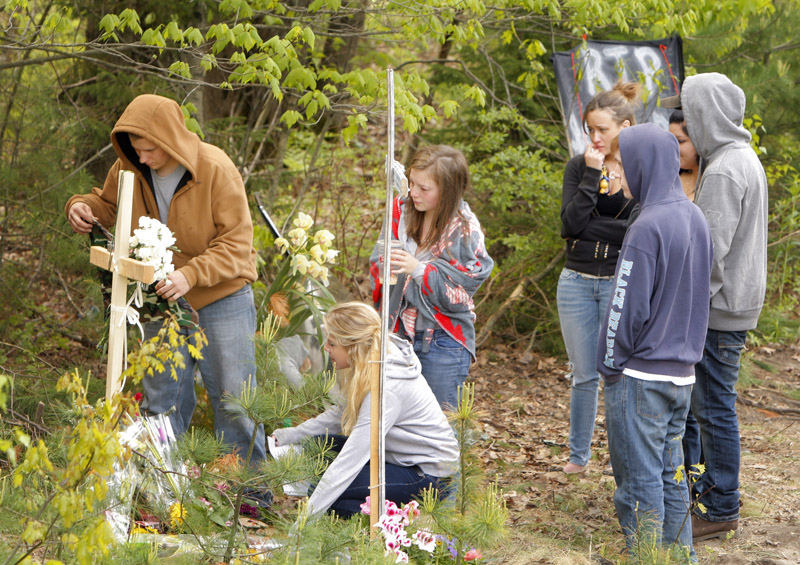 Scarborough High School students gather today at the site of a Saturday car crash on Payne Road in Scarborough that killed Stephen Delano, a senior at Scarborough High School.