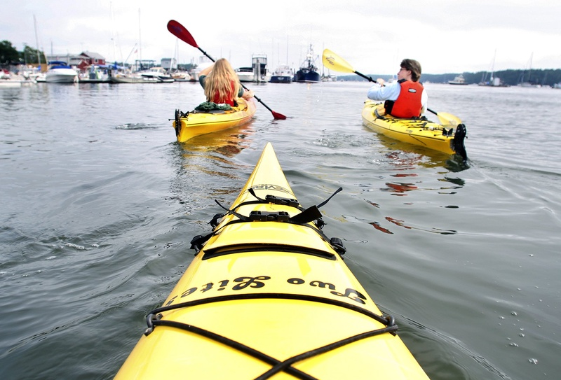Kayakers embark on a paddle off Freeport.