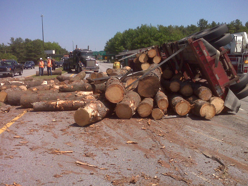 The load of logs and truck blocked two lanes of the connector, leading to other traffic jams as cars were diverted.