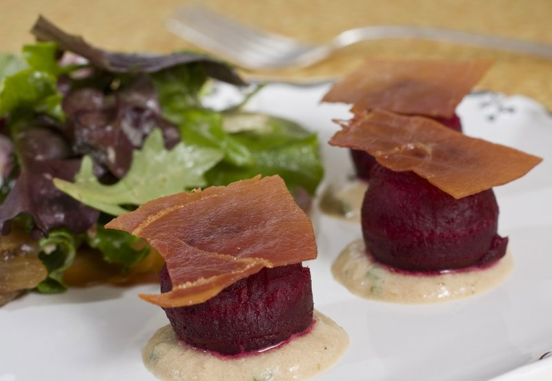 The crisped prosciutto in this spring salad with beets provides great crunchy feel and salty taste, and with far less fat than bacon.