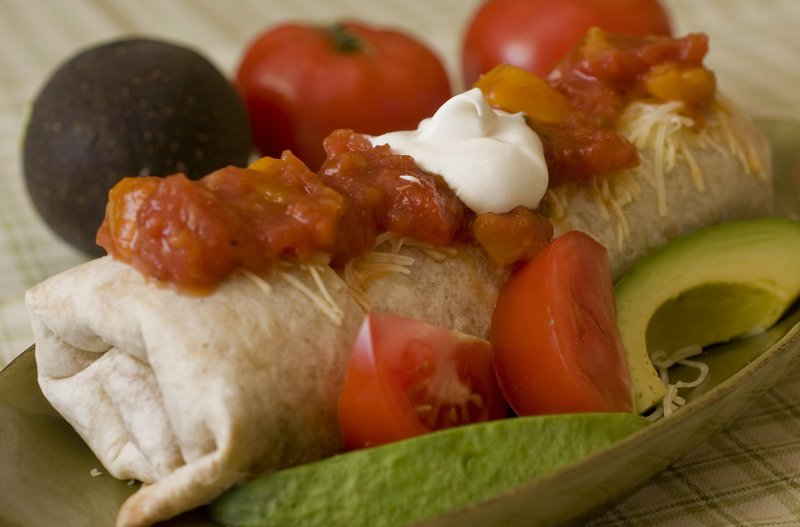 Thanks to their adaptability, burritos – like this chicken, cheese and brown rice number – are a perfect weeknight meal for families with varied and sometimes finicky taste preferences.