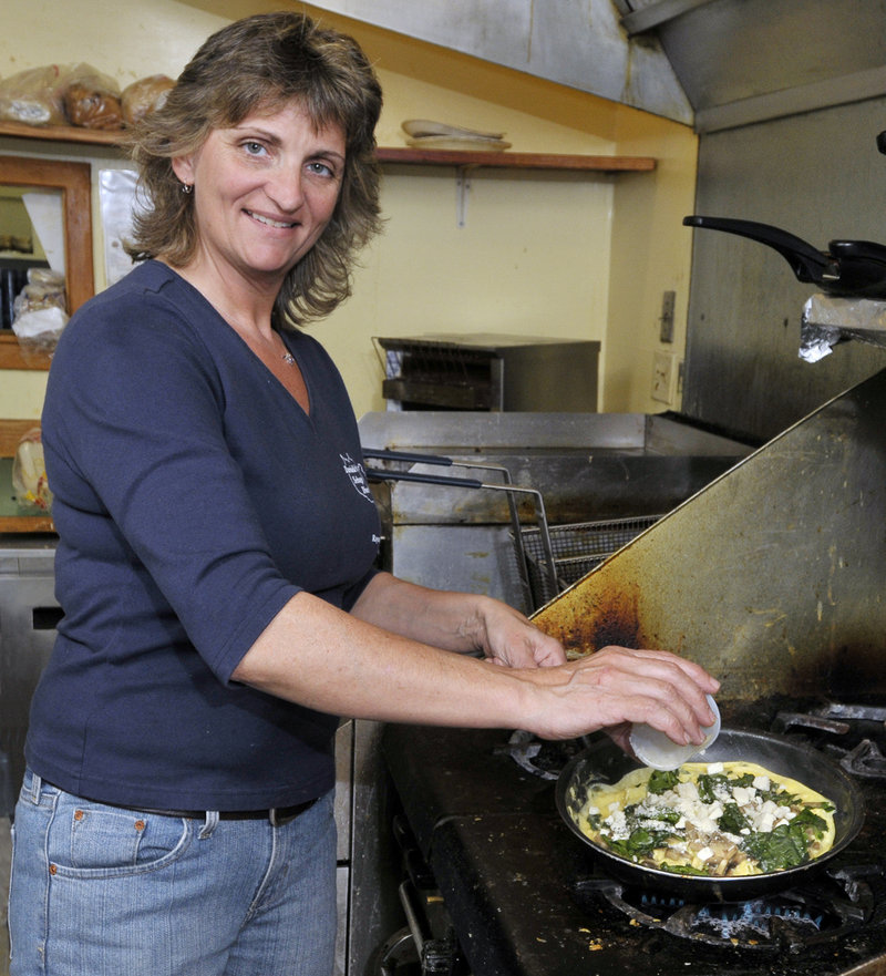 Danielle DeSimon, owner of Danielle's Sebago Diner in Raymond, cooks up an impressive, hearty omelette with spinach, mushrooms and feta cheese.