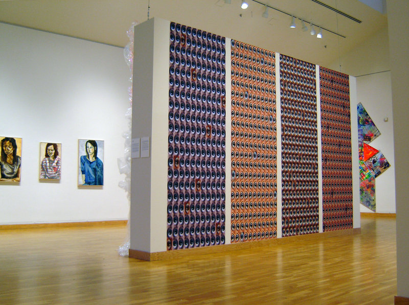 The view of the senior exhibition at the Bates College Museum of art shows, from left, portraits by Emma Sprague, photography by Lisa Hartung and painting by Elizabeth Denham.