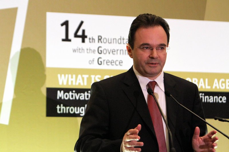 Greek Finance Minister George Papaconstantinou speaks Friday in Athens. He says a debt deal is
