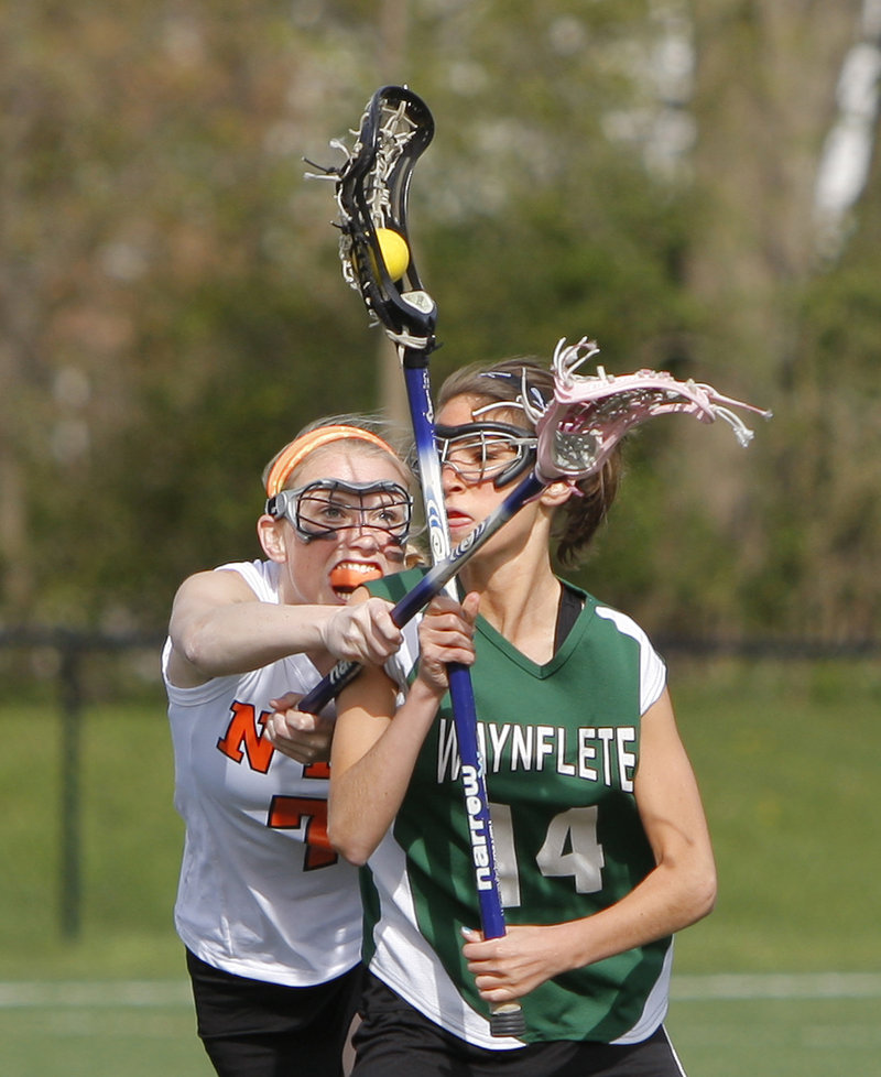Hayley Bright of North Yarmouth Academy defends against Waynflete's Amy Allen during their lacrosse game Friday in Yarmouth. NYA won, 7-6.