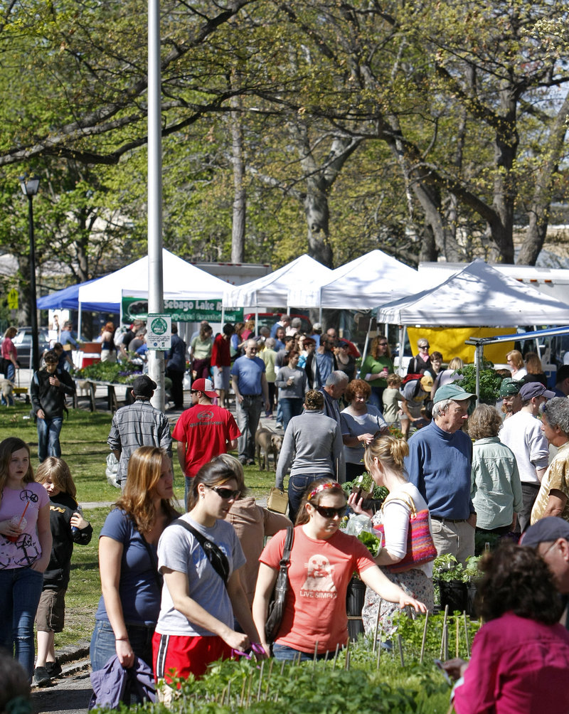 Crowds peruse the produce as the Portland Farmers Market opens for the season at Deering Oaks park on Saturday. The market made Travel + Leisure magazine's 10-best list.