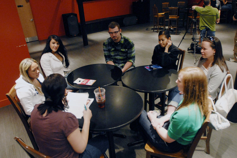 "Jessica Thompson, lower left, a casting director for ""The Real World,"" interviews a group of applicants in Portland. Those who make the cut will participate in more in-depth interviews today."