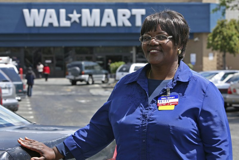 "Walmart employee Betty Dukes stands in front of a Walmart in Pittsburg, Calif. As the first ""named plaintiff"" in Dukes v. Walmart, the ordained Baptist minister also is the face of the largest gender bias class-action lawsuit in U.S. history."