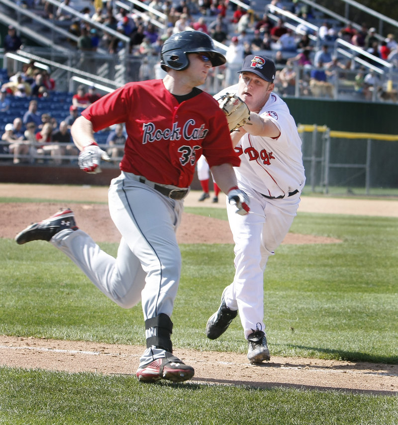 Sea Dogs pitcher T.J. Large tags out Chris Parmelee of the New Britain Rock Cats on the way to first base during Saturday's game at Hadlock Field. Large earned the win in relief of Felix Doubront.