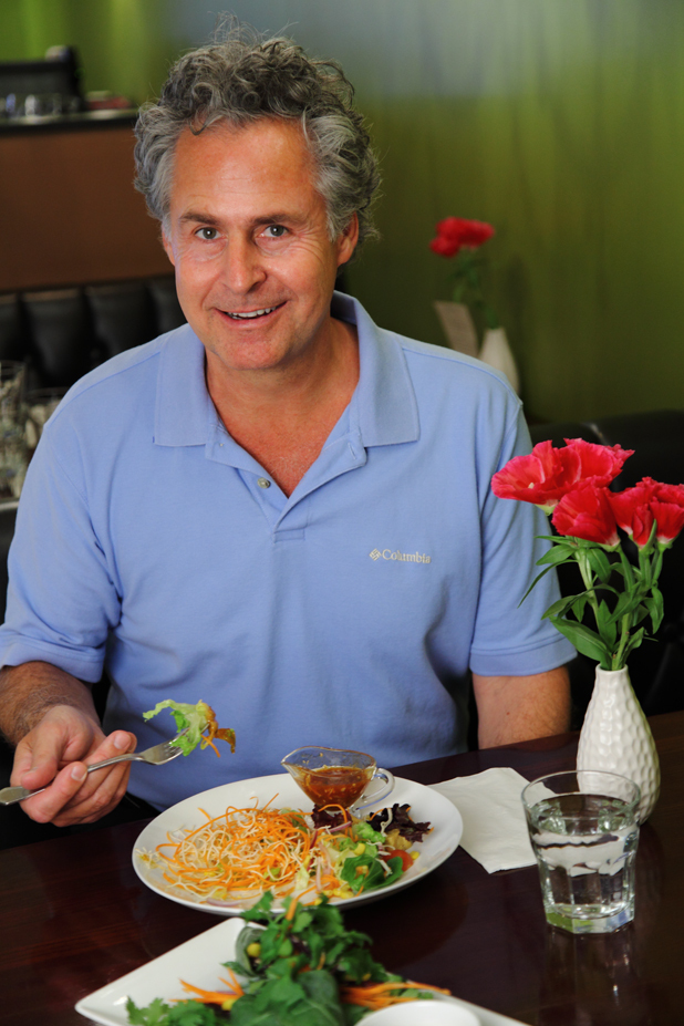 Dr. John Herzog enjoys a vegan meal at the Green Elephant Vegetarian Bistro. He'll be bringing his message of how to improve your health with better diet to Little Lads Bakery during free lunchtime talks every Wednesday this month.