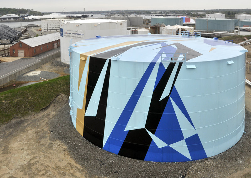 Artist Jaime Gili is visiting the Portland area for his first in-person look at the Sprague Energy oil tank in South Portland that was painted according to his design. Next up is the tank to the left rear.