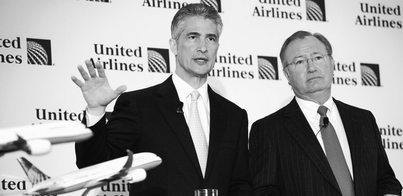Continental Airlines CEO Jeffery Smisek, left, and United Airlines CEO Glenn Tilton discuss the $3 billion-plus deal that would create the world's largest carrier with a commanding position in several top U.S. cities.
