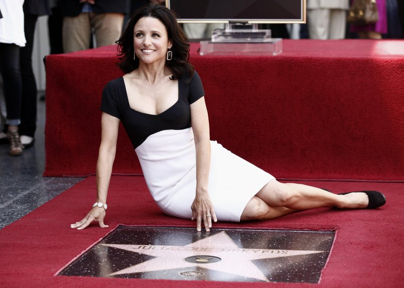 Actress Julia Louis-Dreyfus poses during the dedication of her new star on the Hollywood Walk of Fame in Los Angeles on Tuesday.