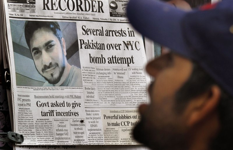 A Pakistani man in Islamabad reads a morning newspaper Wednesday, with the headline story about arrests in the Times Square bomb attempt. Pakistan army officials do not believe the Pakistani Taliban were behind the Times Square bomb attempt as the insurgent group has claimed.