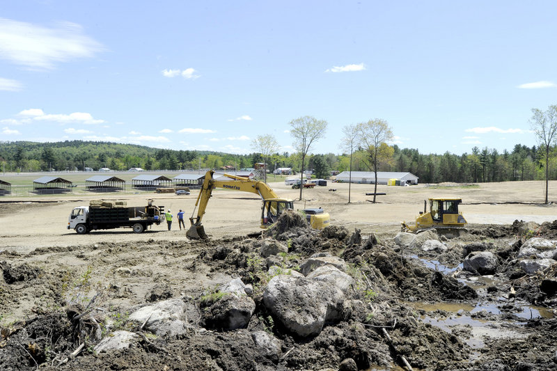 Heavy equipment clears the site behind the Oxford Fairgrounds where promoter Frank Chandler will run the Nateva Music & Camping Festival this summer.