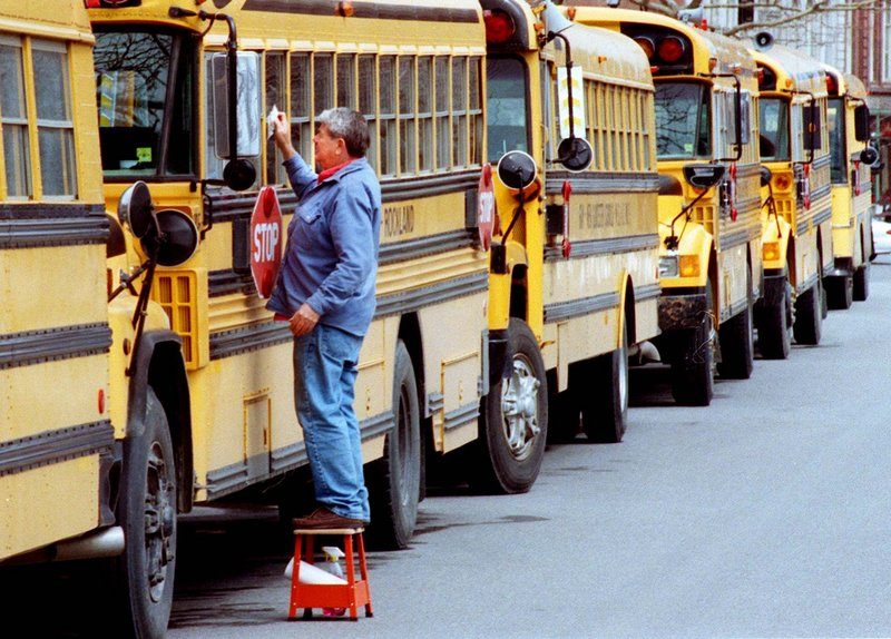 School buses carry kids to their classrooms, but there could be far fewer people there to teach them, a Portland principal says.