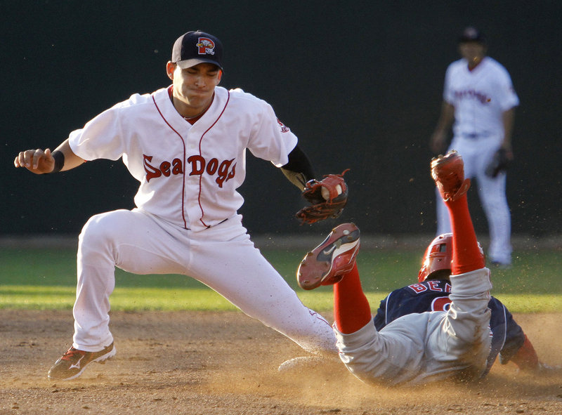 Quintin Berry of the Reading Phillies steals second base Wednesday night as Jose Iglesias of the Portland Sea Dogs takes the late throw in the third inning of the Phillies' 2-1 victory at Hadlock Field. Portland pitcher Casey Kelly was taken off his pitch count and went five strong innings.