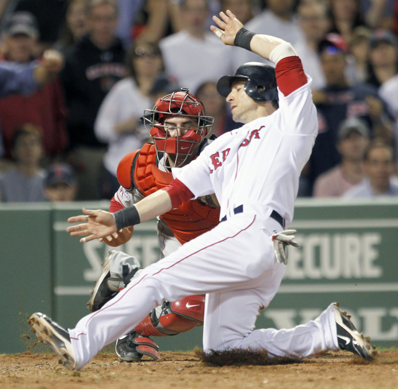 Marco Scutaro of the Boston Red Sox is cut down at the plate Wednesday night as catcher Mike Napoli of the Los Angeles Angels applies the tag. Scutaro was trying to score from second on a single to left by Kevin Youkilis in the seventh inning of Boston's 3-1 victory at Fenway Park.