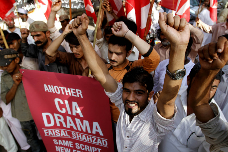 Supporters of the Pakistani religious party Jamat-e-Islami rally to support Faisal Shahzad, the suspect in the failed Times Square bombing, in Karachi on Thursday. Pakistan says the U.S. has joined it in questioning four alleged members of an al-Qaida-linked militant group.
