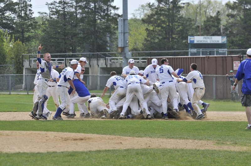 Somewhere at the bottom of that dog pile you'll find Craig Woodbrey, whose hit with two outs in the ninth drove in the winning run for St. Joseph's in a conference final last Sunday.