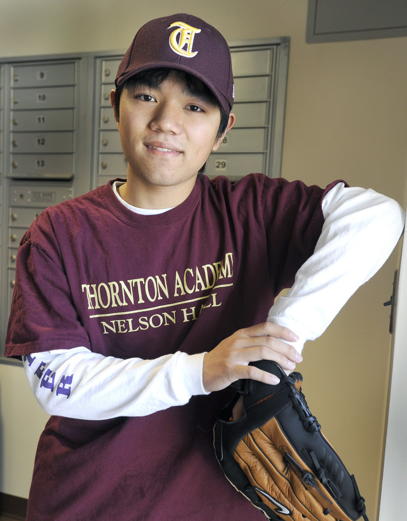 "Linfeng ""Patrick"" Zhu of China has taken up baseball at Thornton Academy because ""I wanted to try something American-style. I love baseball."""