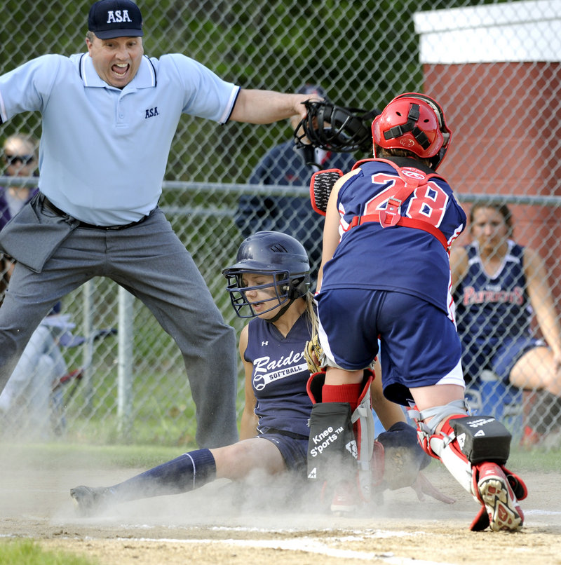 Brylie Walker of Fryeburg Academy slides safely across the plate Friday as Gray-New Gloucester catcher Sammie Wilkins applies a late tag. Fryeburg won the game between undefeated Class B teams, 10-4.