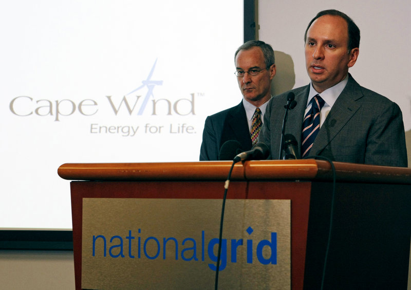 Tom King, right, president of National Grid, and Jim Gordon, president of Cape Wind, announce a deal between the two companies Friday in Waltham, Mass. National Grid has agreed to buy electricity from the nation's first offshore wind farm, planned off Cape Cod.