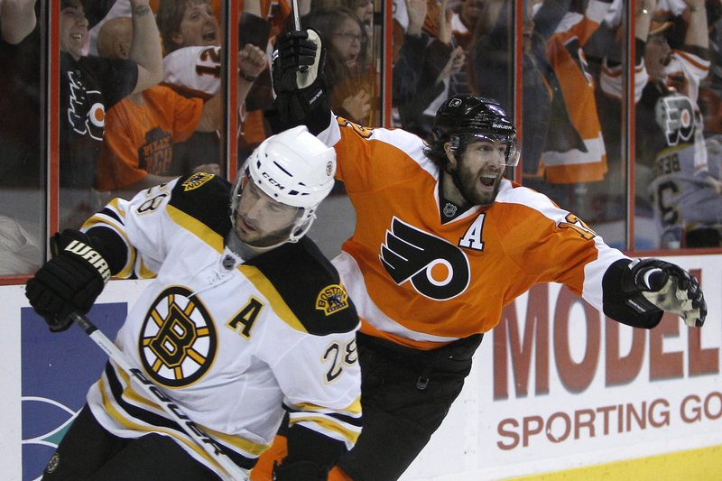 Simon Gagne of the Philadelphia Flyers celebrates Friday night after scoring the overtime goal that defeated the Boston Bruins 5-4 and kept the series alive.