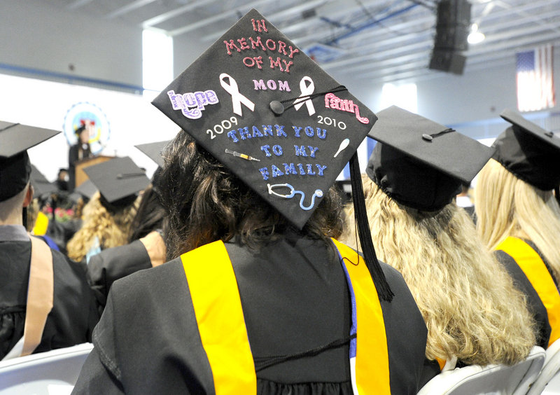 Sarah Fox wears her appreciation as she and 400 others graduate Saturday. Fox's mother died about a year ago, making commencement even more poignant for Fox.