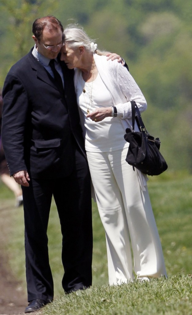 Actress Vanessa Redgrave hugs an unidentified man after a funeral for her younger sister, actress Lynn Redgrave, at St. Peter's Cemetery in Lithgow, N.Y., on Saturday. Lynn Redgrave died a week ago at age 67.