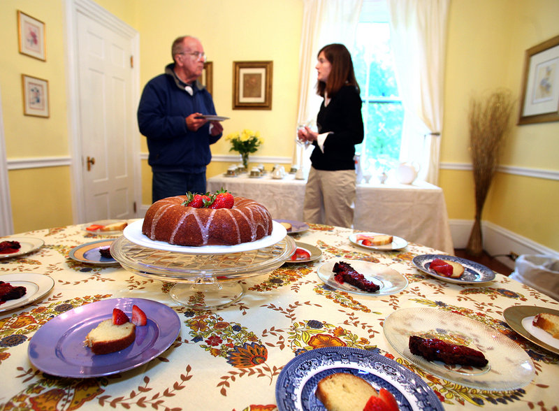 Innkeeper Beth O'Connor chats with Ed Pert of Georgetown as he tries a piece of afternoon tea cake with vanilla glaze in the dining room of Abigail's Inn. Pert was looking for a place stay this summer.