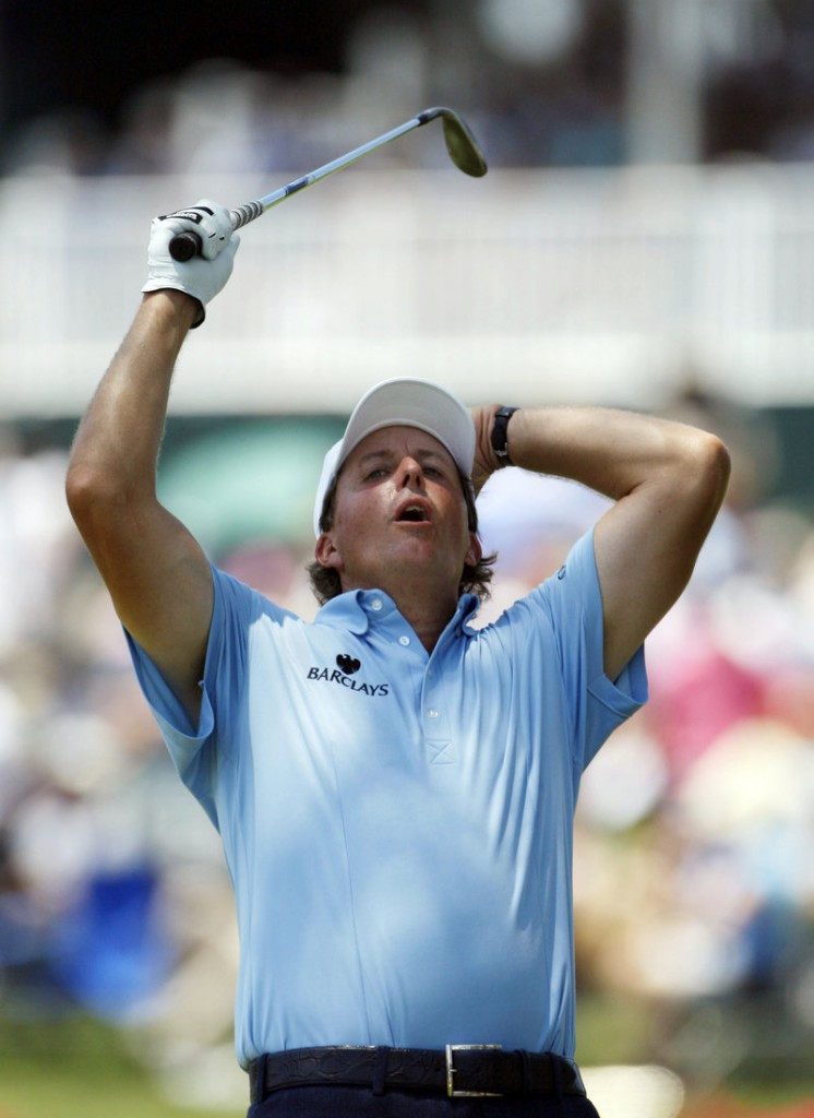 Phil Mickelson reacts Saturday after missing a chip for eagle on the 16th hole at The Players Championship. Mickelson shot a 66 to climb back into contention.