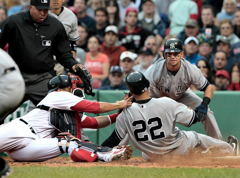 Randy Winn of the New York Yankees is cut down at the plate as Red Sox catcher Victor Martinez applies the tag Saturday. Turned out it didn't matter much. Yankees 14, Red Sox 3.