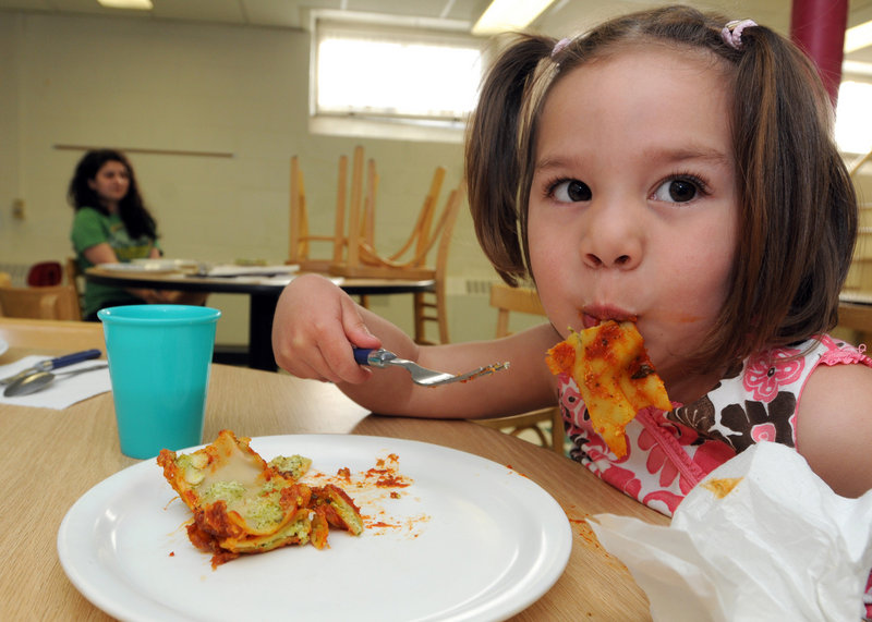 Avery Bennett, 3, enjoys vegetable pesto lasagna at an evening child-care program of Community Action Brattleboro Area. The meal is part of a federal pilot program to provide nutritious dinners to lower-income children.