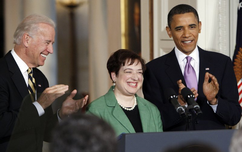 President Obama and Vice President Joe Biden applaud as Solicitor General Elena Kagan is introduced as Obama's choice for Supreme Court justice in the White House on Monday. Kagan is hearing some criticism from left and right alike, but observers expect the Senate to confirm her.