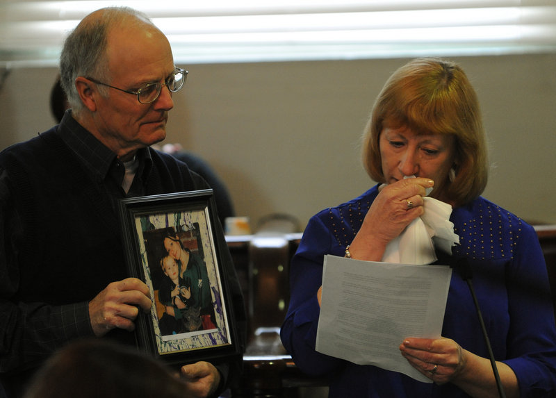 Richard Grindal holds a picture of his daughter, Rachel, on Monday as his wife, Rita, reads a statement during the sentencing of Corina Durkee and Earl Bieler for their daughter's murder.
