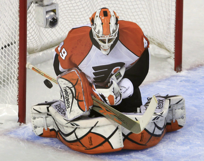 Michael Leighton replaced injured starter Brian Boucher in the second period and made 14 saves in the 4-0 win.