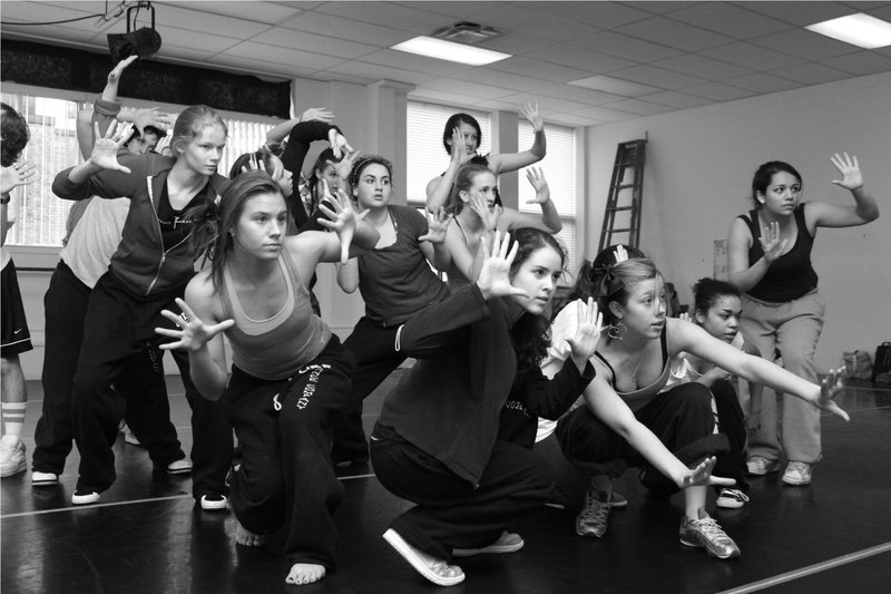 Members of UpBeat Feet Dance Company practice a hip-hop combination for their performance, scheduled for May 22 at Portland High School.