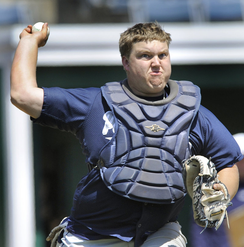 Penn State Greater Allegheny catcher Josh Kubisz comes up throwing and gets a Southern Virginia runner at first base.