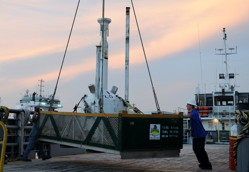"This image provided by the Deepwater Horizon Unified Command shows a small pollution containment chamber, known as the ""top hat,"" being loaded onto the deck of the motor vessel Gulf Protector in Port Fourchon, La., on Monday."