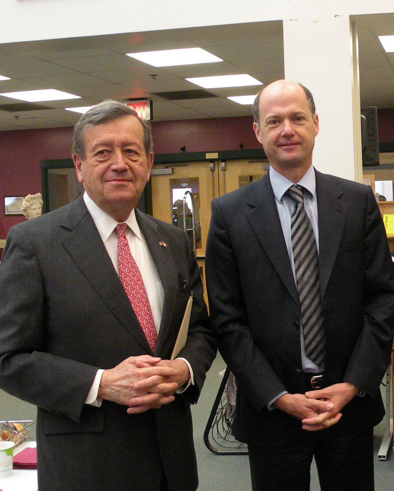 Severin Beliveau, left, Maine's honorary French consular, escorts Christophe Guilhou, France's new consul general.
