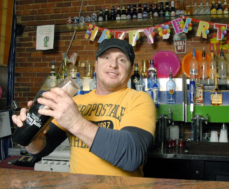 Bartender Mike Ingalls mixes drinks at the Cactus Club in Portland, known as a tourist hotspot and a place where it's always somebody's birthday ...or at least you can feel free to party that way.