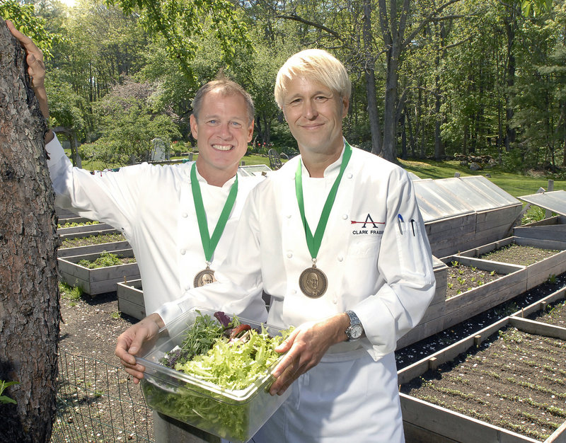 Mark Gaier and Clark Frasier, chef/owners of Arrows and MC Perkins Cove restaurants in Ogunquit, pose with the Best Chef/Northeast medals bestowed on them by the James Beard Foundation.