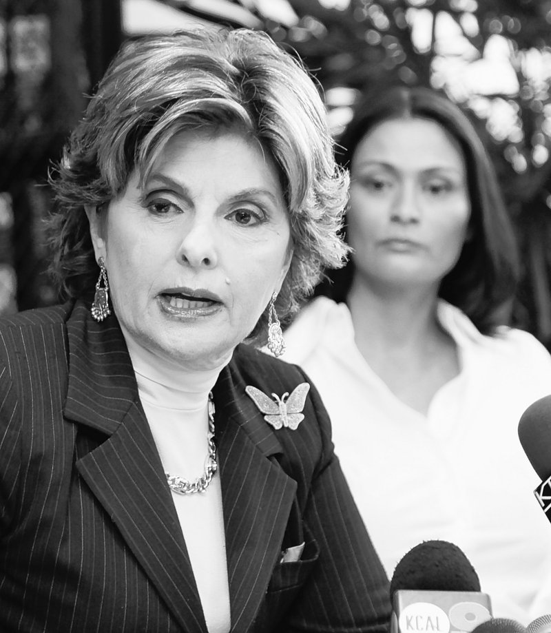Attorney Gloria Allred speaks for her client, British actress Charlotte Lewis, background, in Los Angeles Friday. Lewis alleges that director Roman Polanski sexually victimized her in Paris when she was 16.
