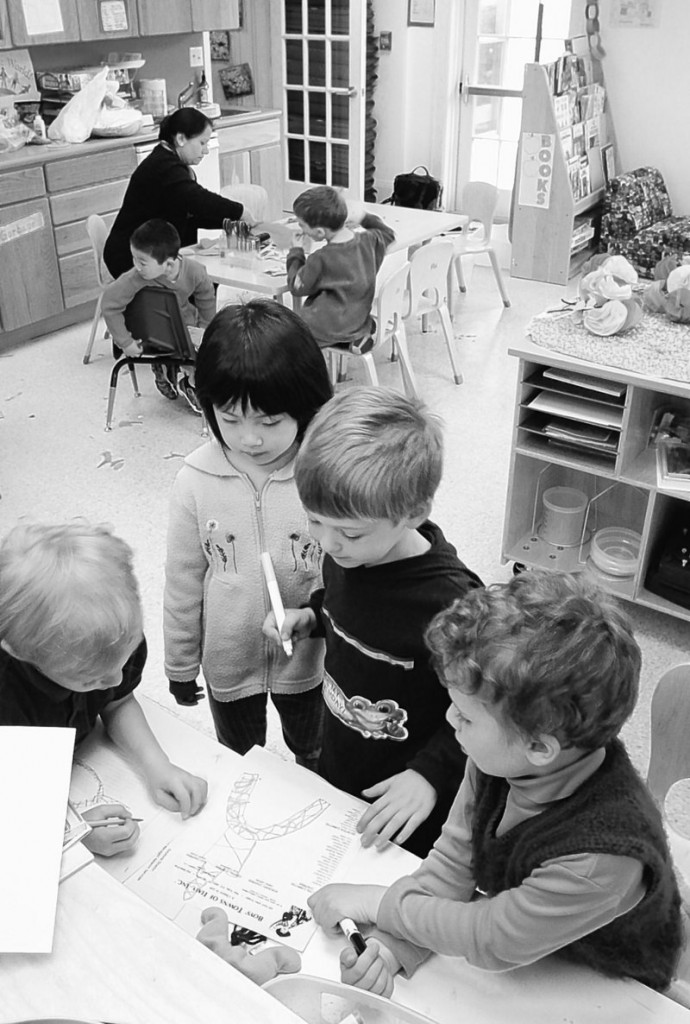 Children participate in supervised activities at a Yorktown, N.Y., child care center. According to the latest findings of a long-running study, teens who spent a lot of time in day care as preschoolers are more prone to risky behavior than other American adolescents – though the differences are slight.