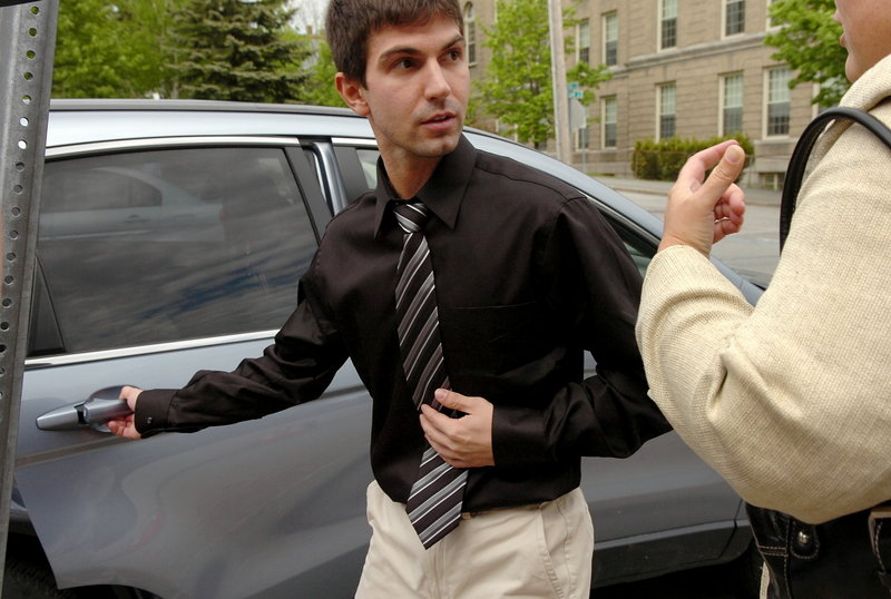 Bridget Brown/Bangor Daily News Derek Stansberry of Riverview, Fla., leaves U.S. District Court in Bangor after he was released on $20,000 bail Friday. He allegedly passed a note that said he had a fake passport and told federal air marshals he had dynamite aboard a Paris-to-Atlanta flight on April 27.