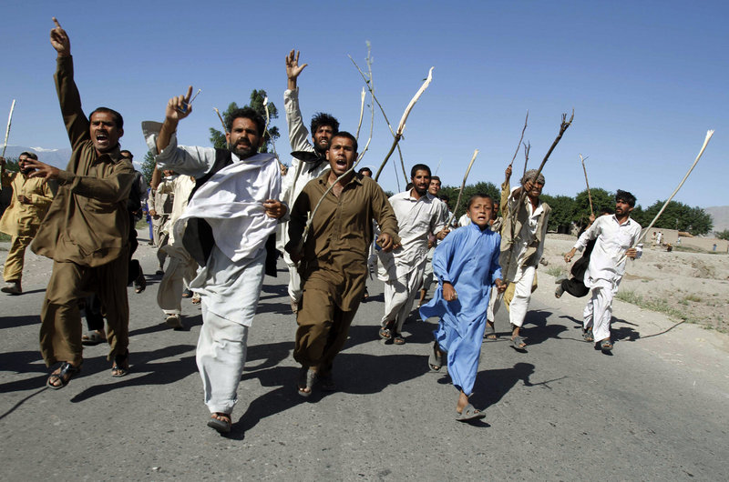 Residents protest the killing of alleged civilians by NATO forces in an overnight raid at Surkhrod, Afghanistan, on Friday.